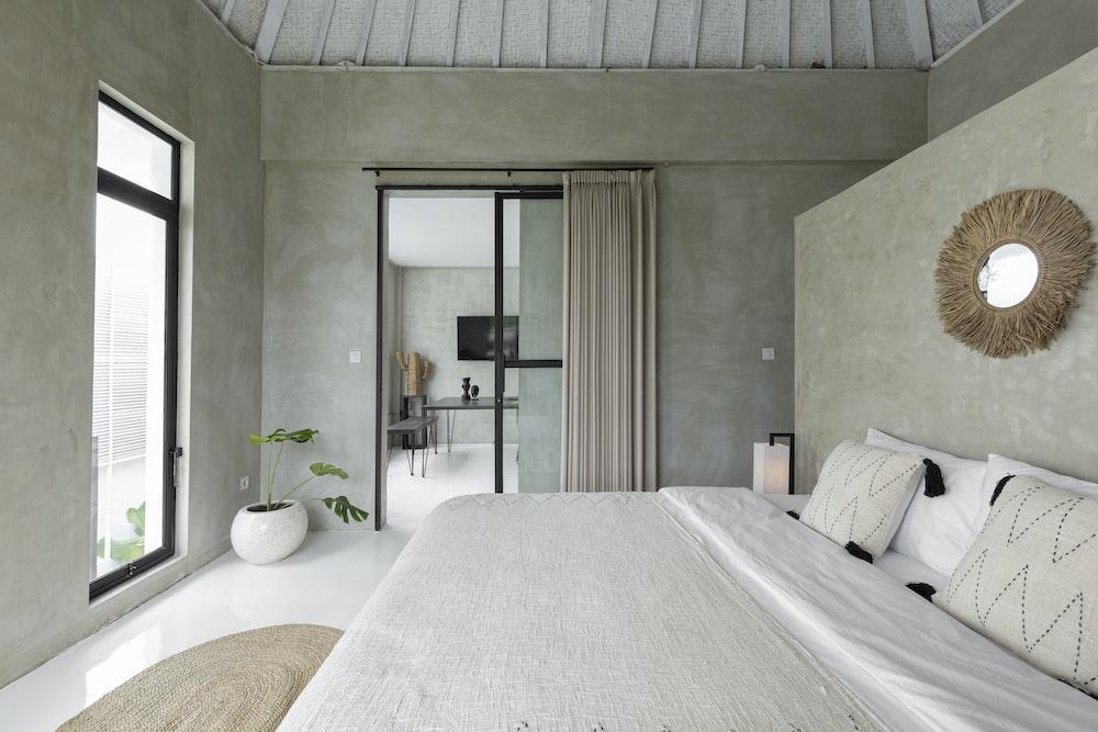 white bed near glass sliding door