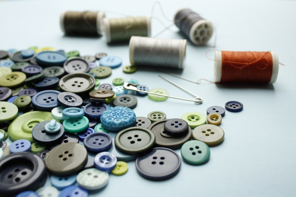 blue and white buttons with blue and red buttons