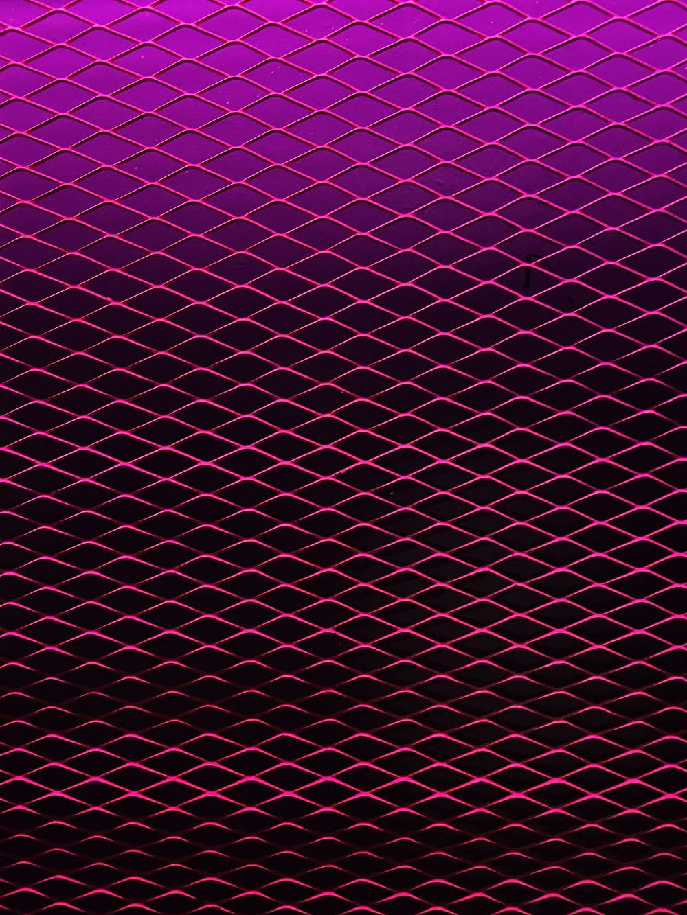 purple and pink polka dot textile