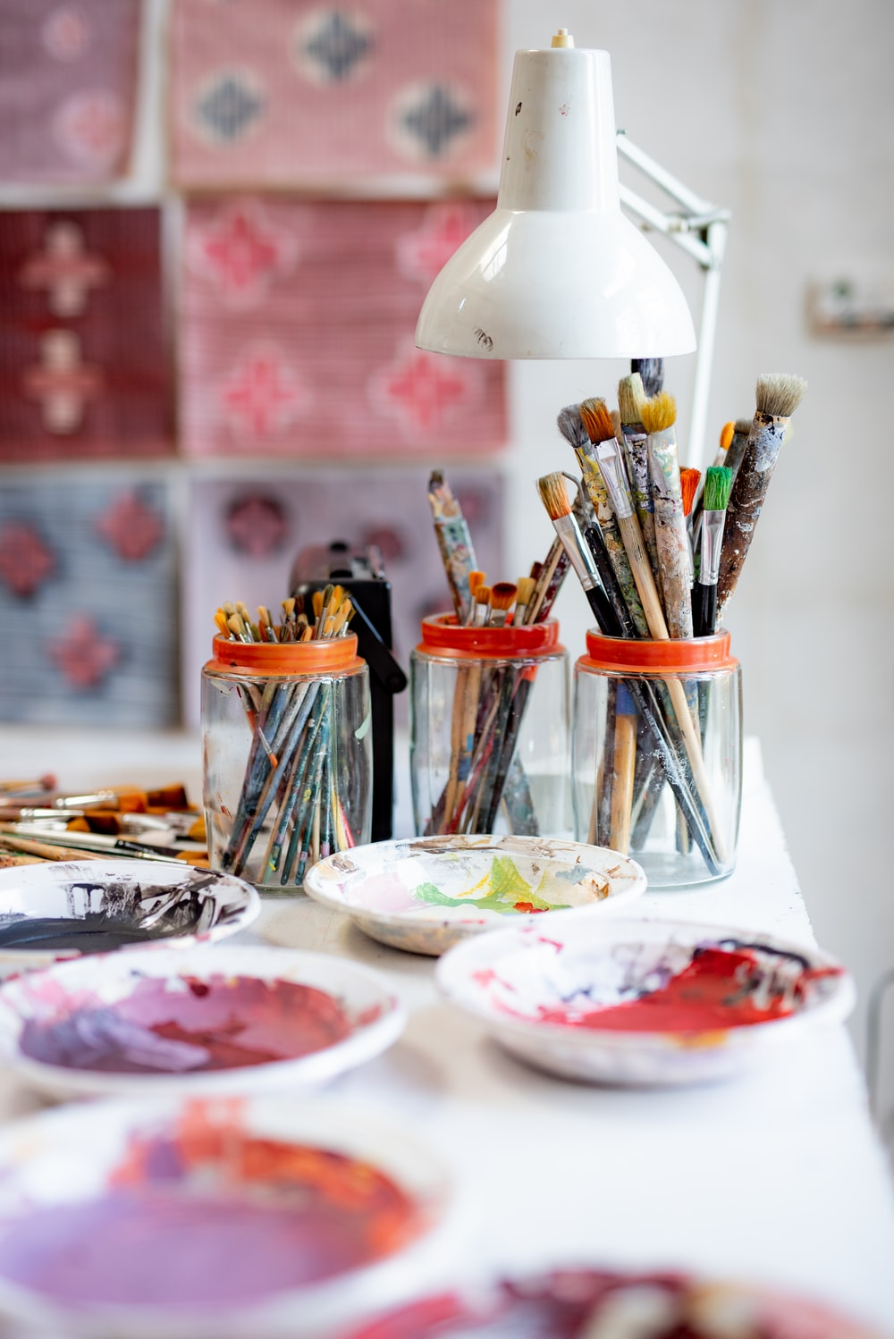 white ceramic plate with paint brushes and paint brushes