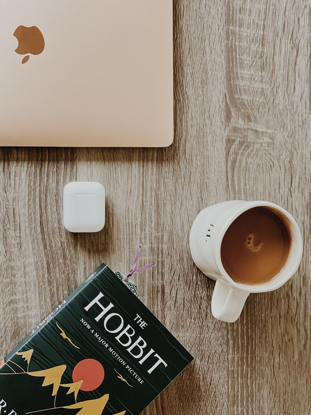white ceramic mug beside white laptop computer