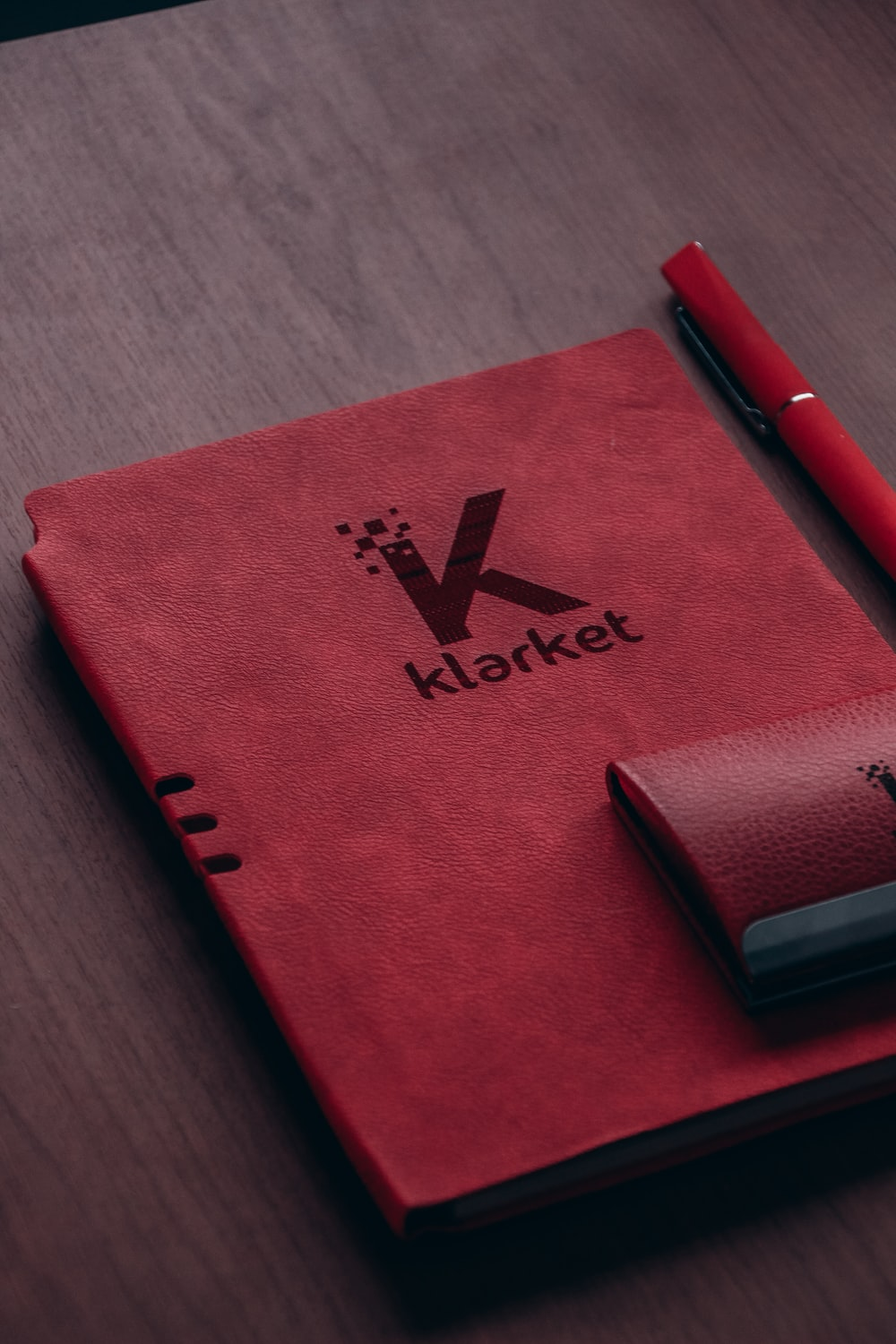 red book with purple click pen