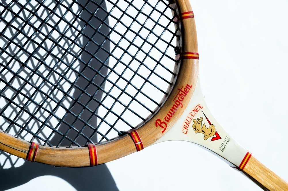 white and brown tennis racket