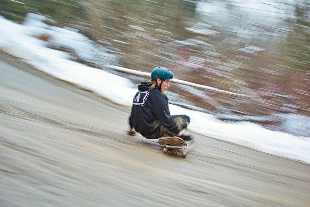 man in blue helmet riding on brown wooden board