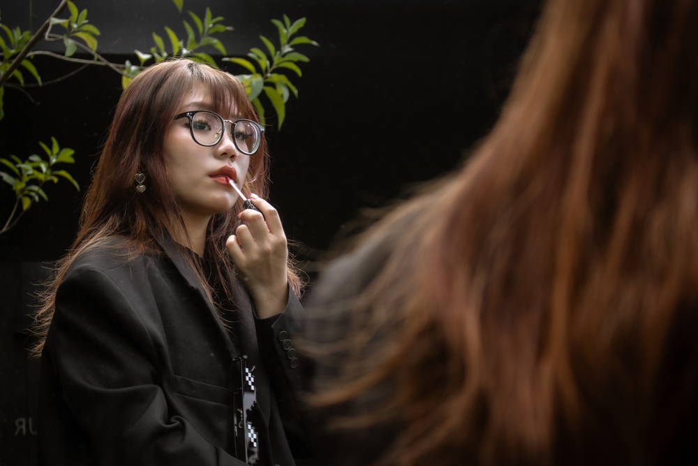 woman in black leather jacket wearing eyeglasses