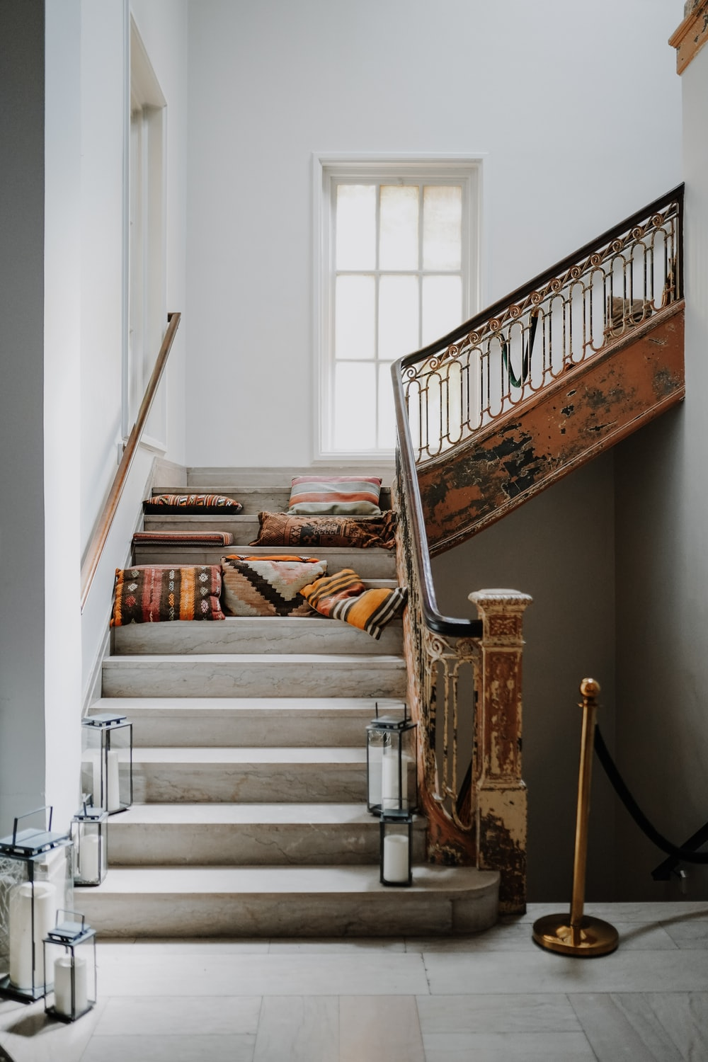 brown wooden staircase with books