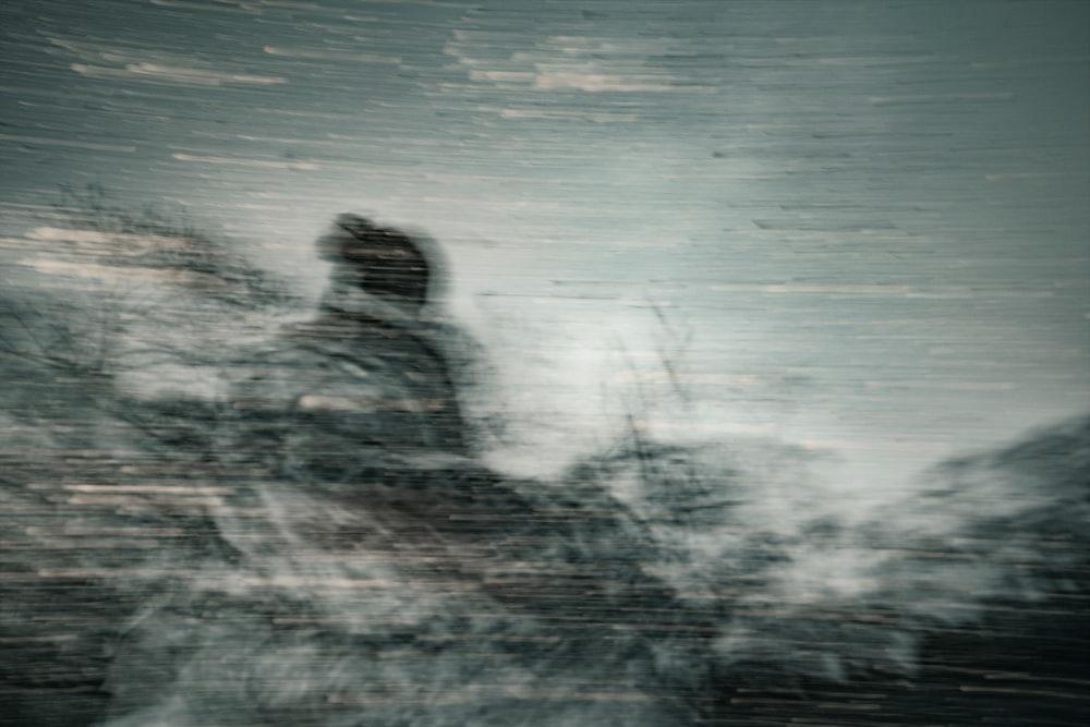 man in black jacket standing on water