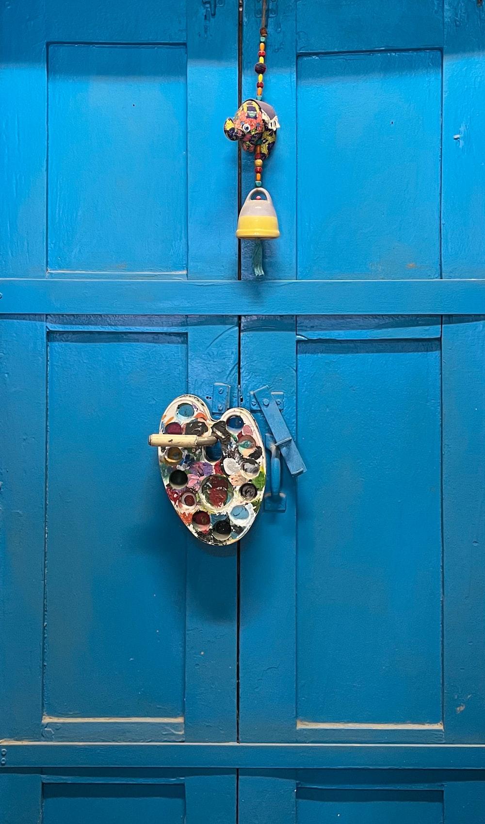 brass padlock on blue wooden door