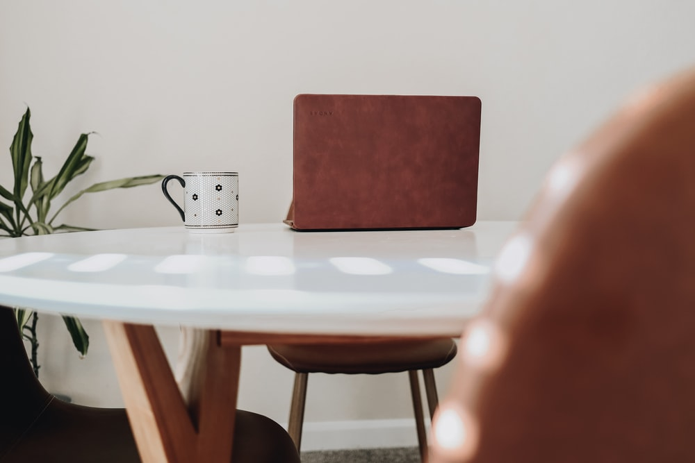 red chair beside white table