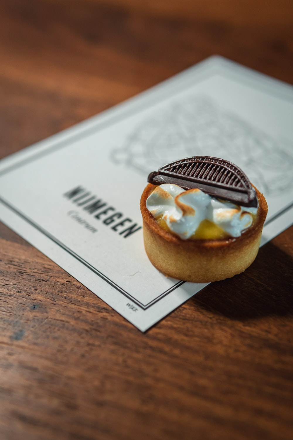 brown and white pastry on white paper
