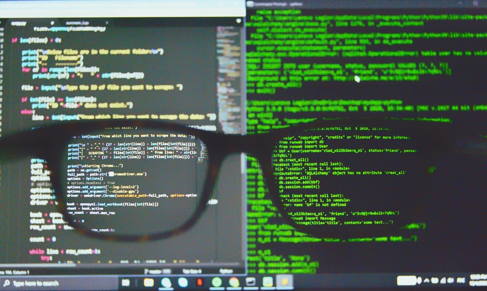 black framed eyeglasses on computer screen