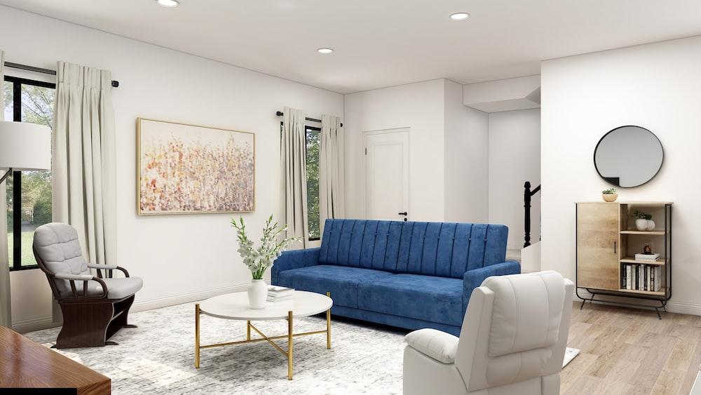 blue sofa near white wall