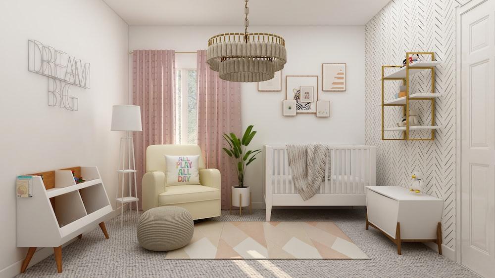 white sofa chair beside white window curtain