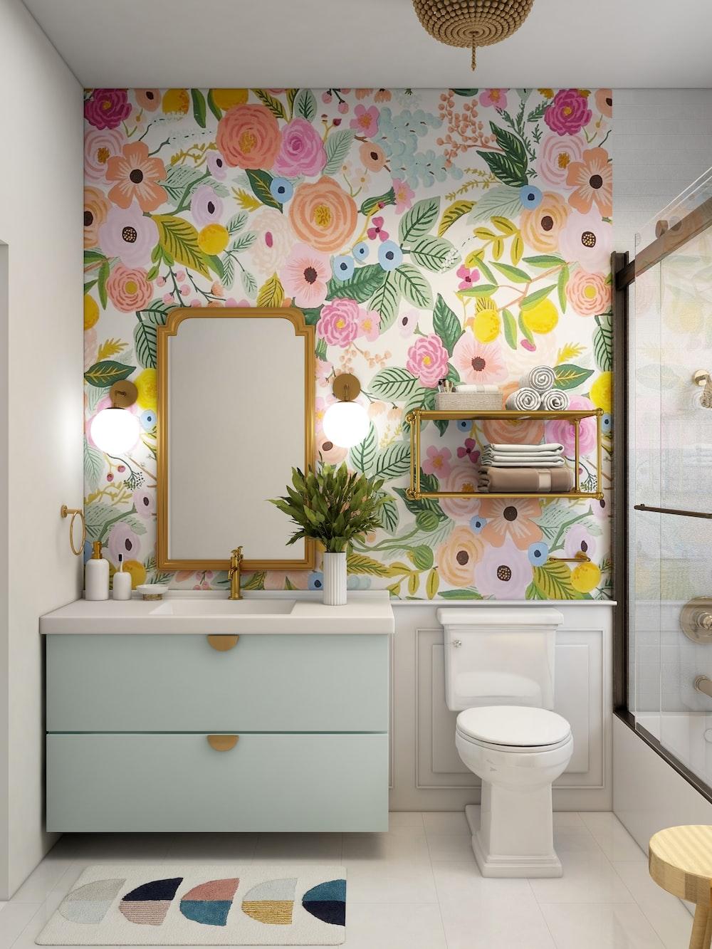 white ceramic toilet bowl near white ceramic sink