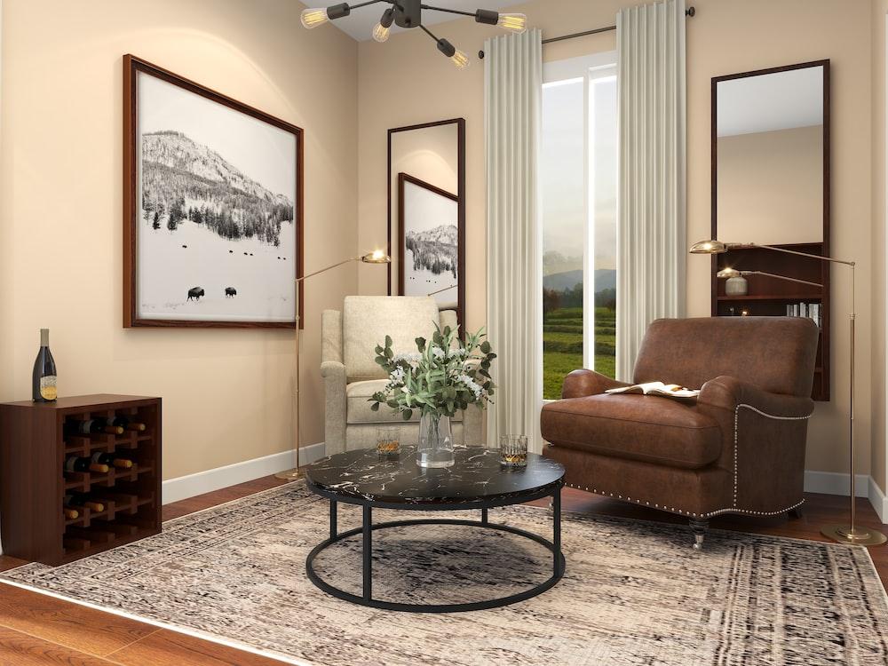 brown sofa near glass round table