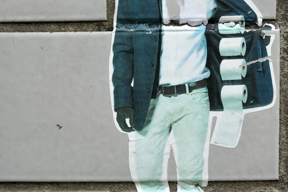 man in blue and white long sleeve shirt and white pants