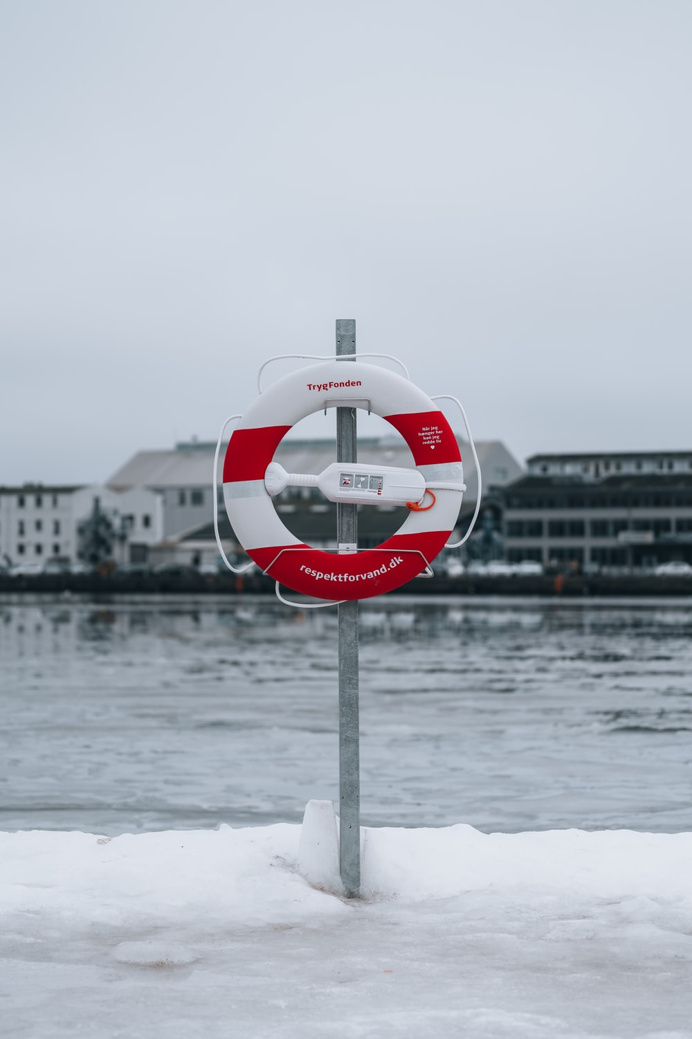 white and red round device on gray metal post