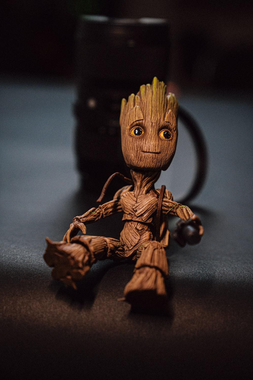 brown wooden animal figurine on black table