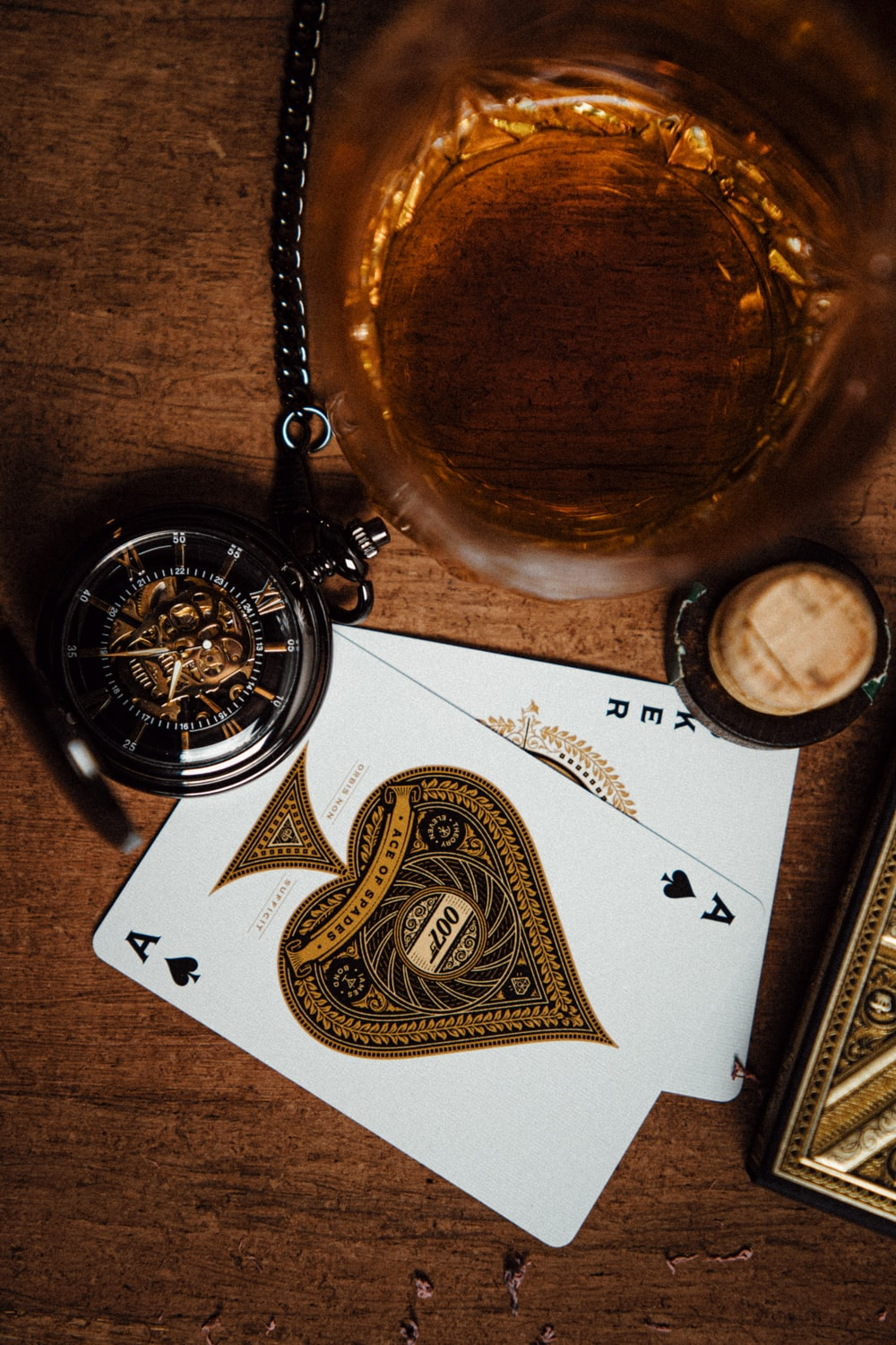 gold pocket watch on white paper