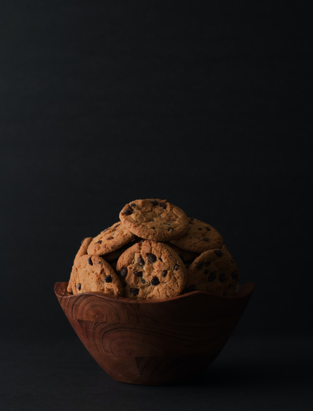 brown cookies in brown wooden bowl