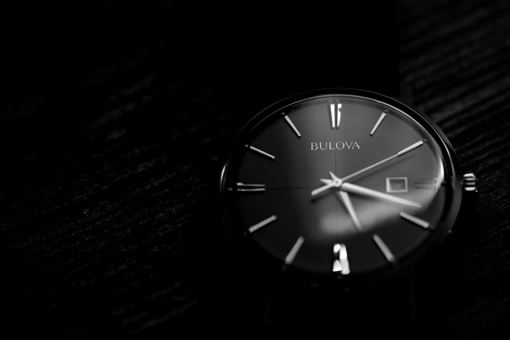 black and white analog watch at 10 00