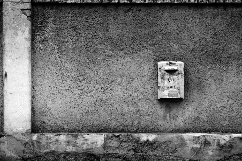 grayscale photo of a wall mounted device