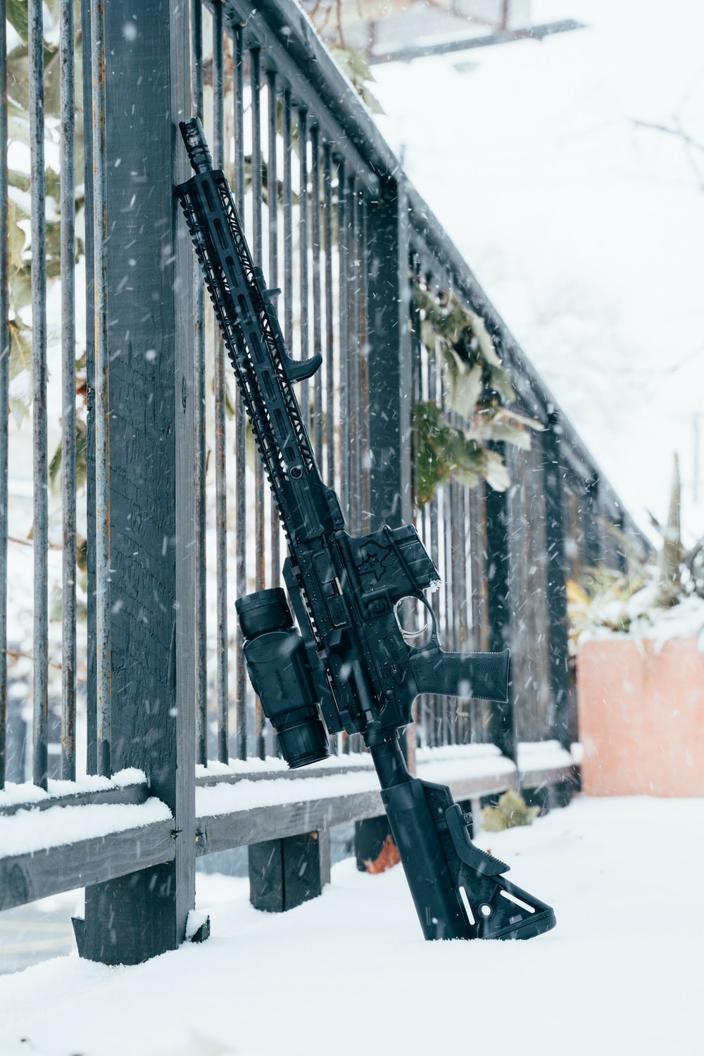 black rifle on snow covered ground