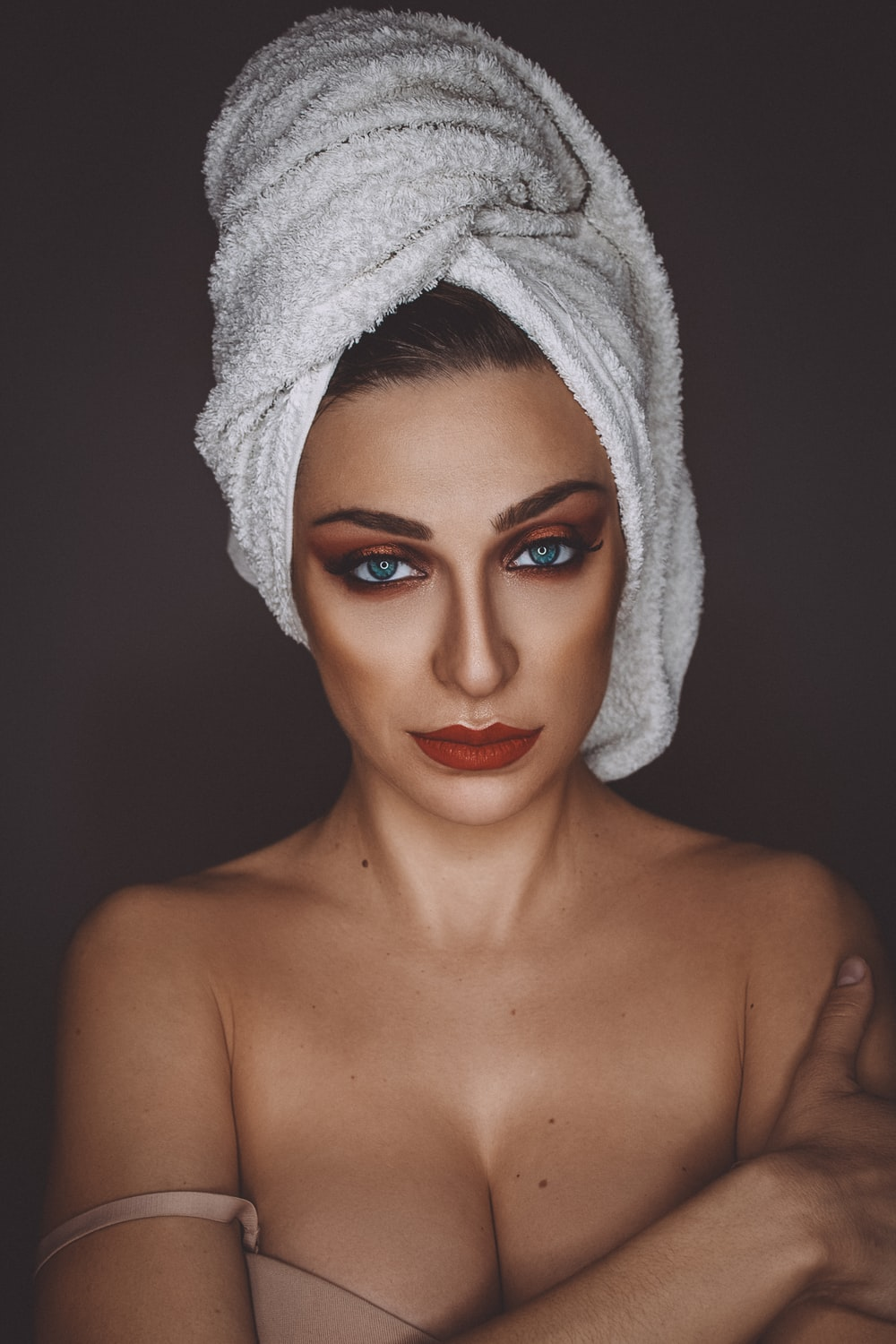 woman with white towel on head