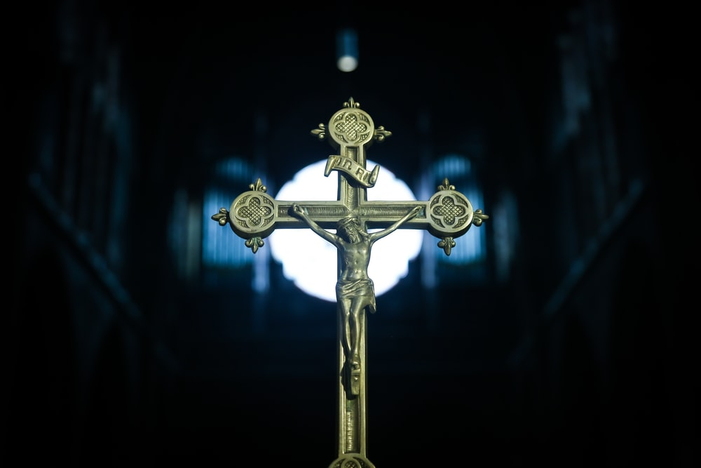 gold cross with blue light