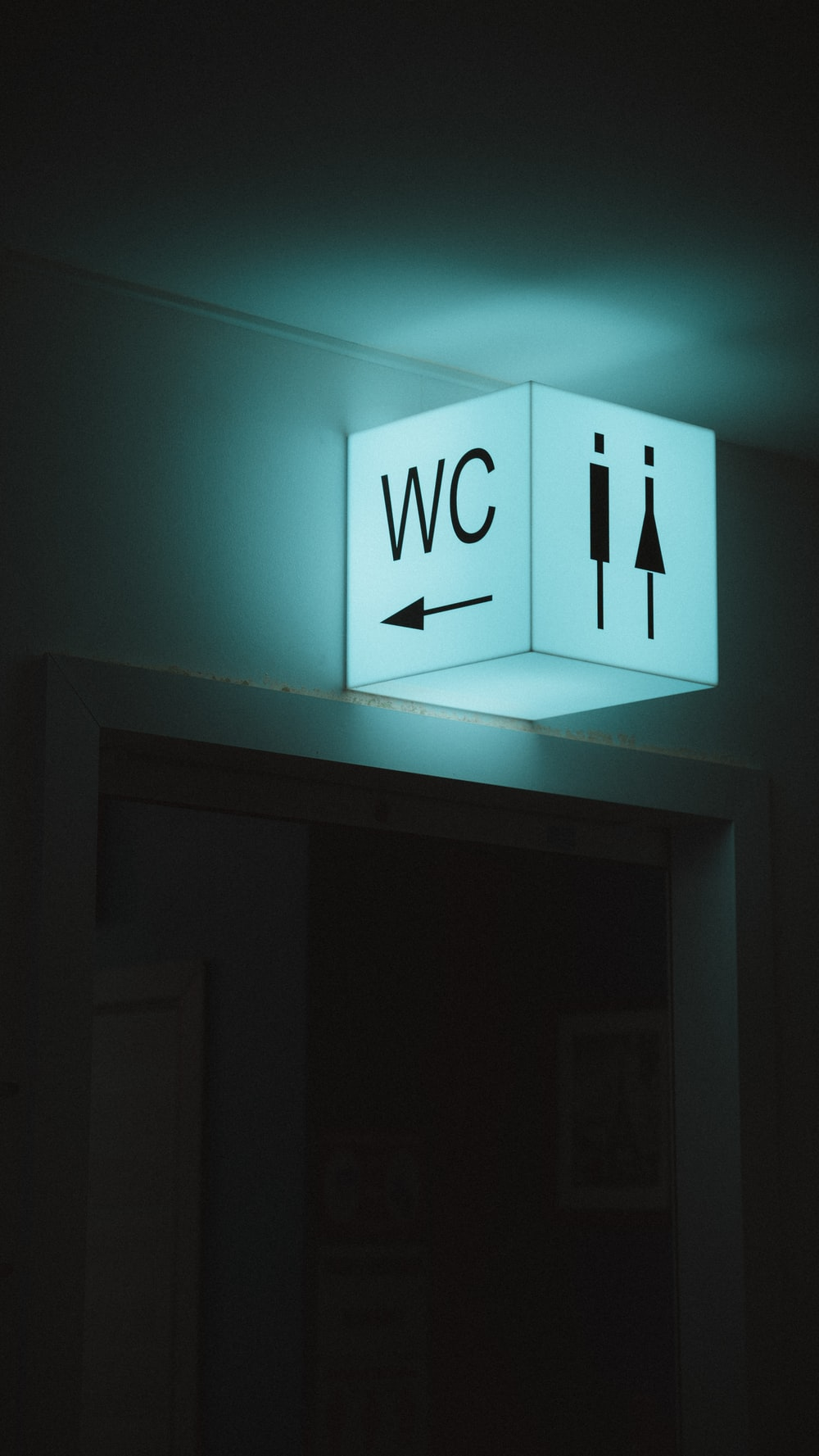 white and blue wall mounted exit sign