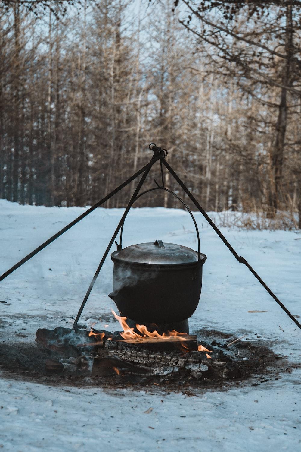 black steel pot on fire