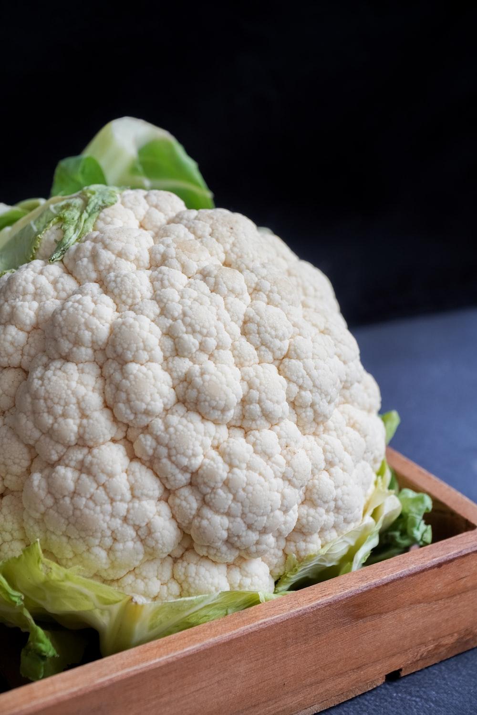 white cauliflower on black textile