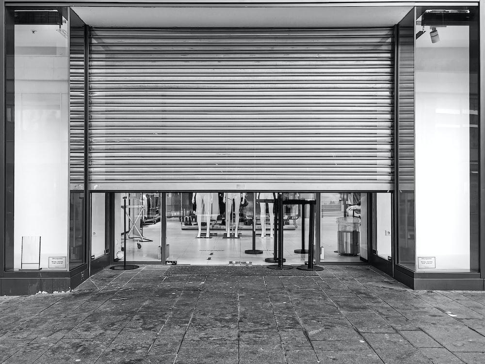 grayscale photo of a garage door