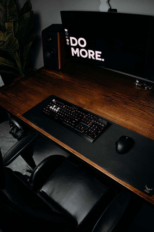 black computer keyboard on brown wooden desk