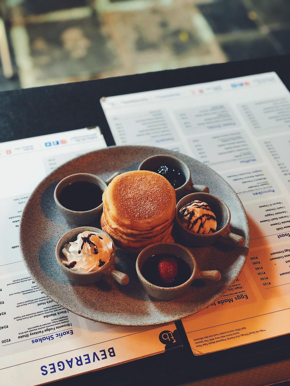 brown ceramic mug on brown wooden tray