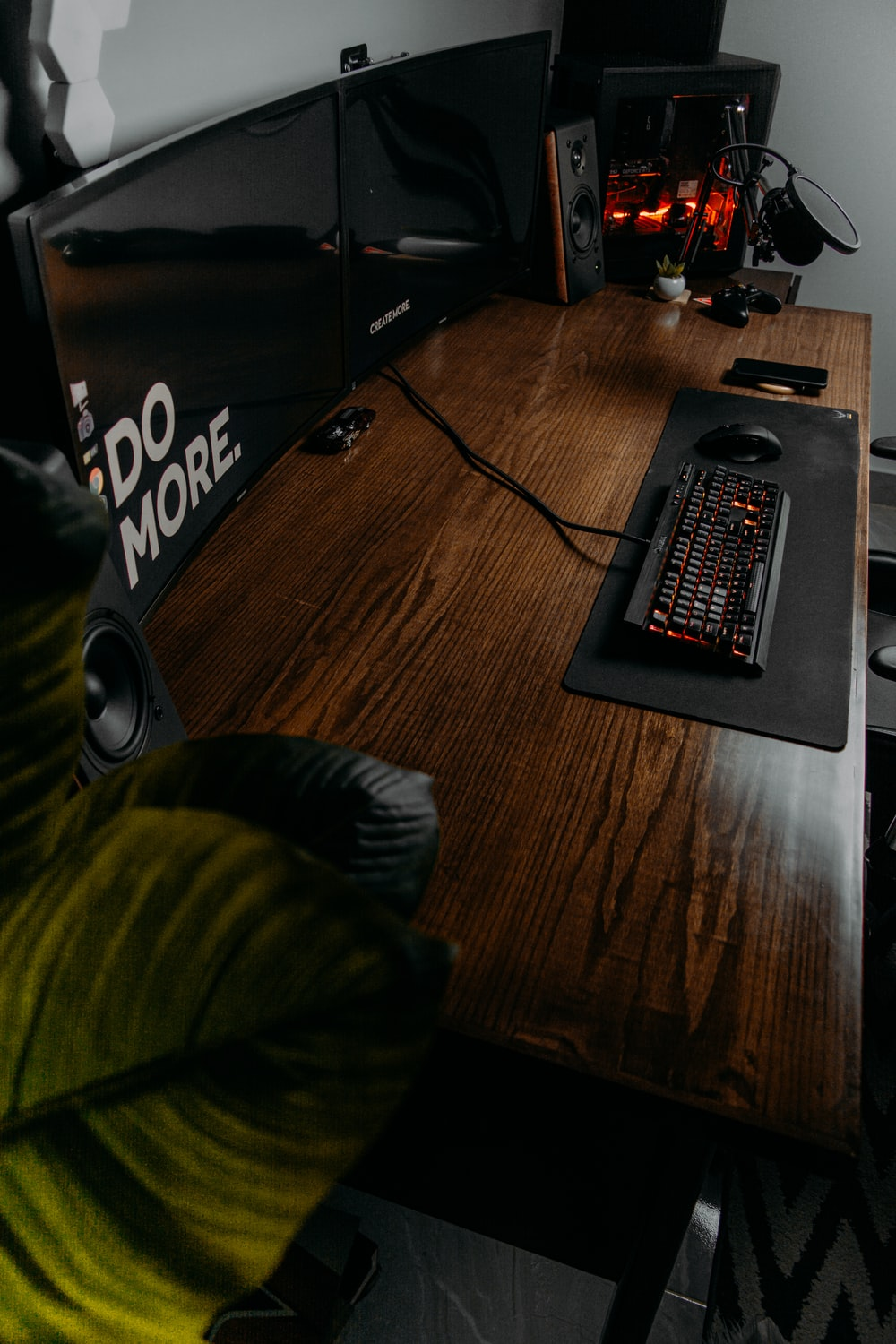black and red computer keyboard on brown wooden table