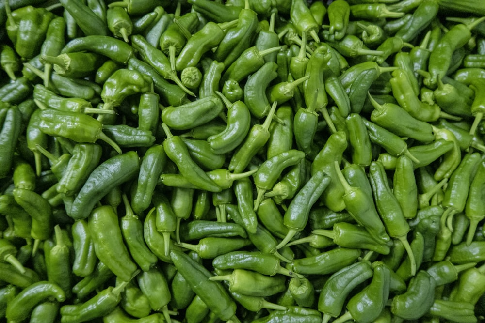 green chili peppers on green leaves