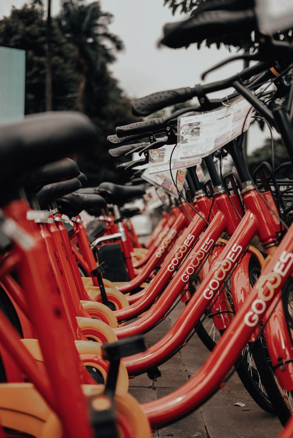 orange bicycle on black steel frame