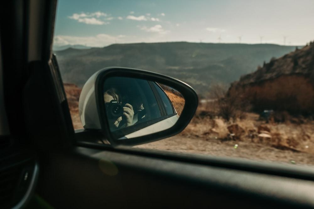 car side mirror showing mountain range