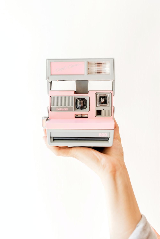 pink and white polaroid camera
