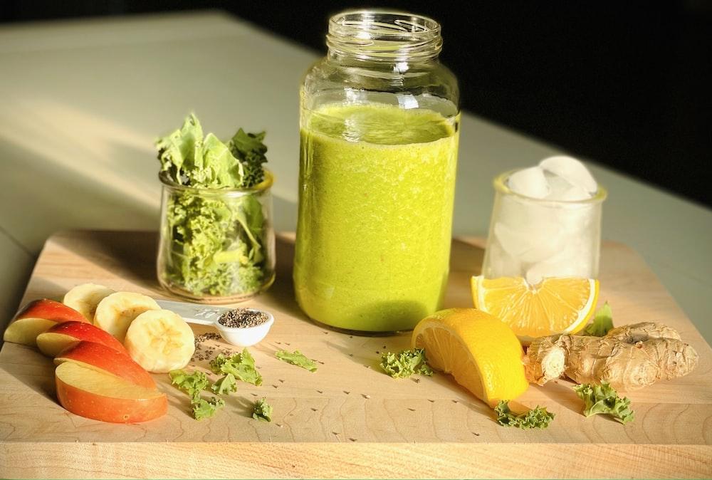 clear glass jar with green liquid