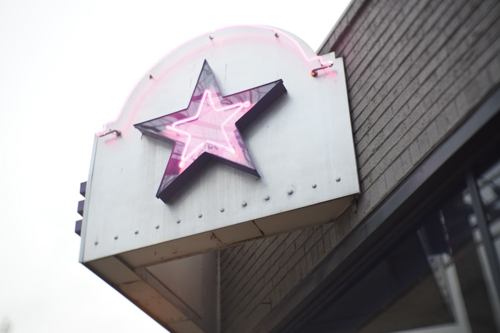 white and pink star print concrete building