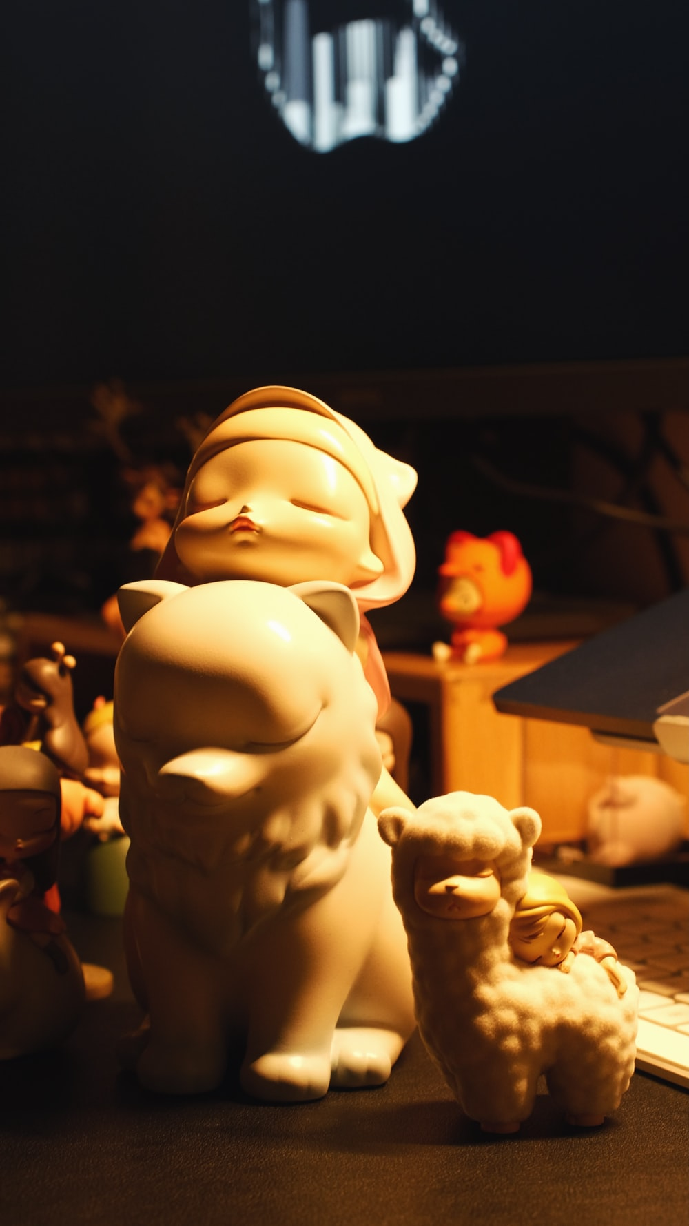 white ceramic figurine of man and woman