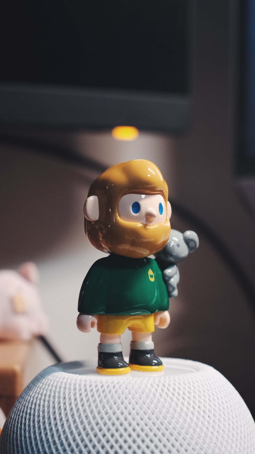 brown haired boy in green shirt plastic toy
