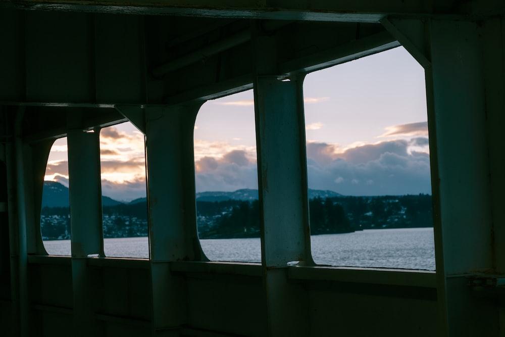 gray concrete bridge over the sea during daytime