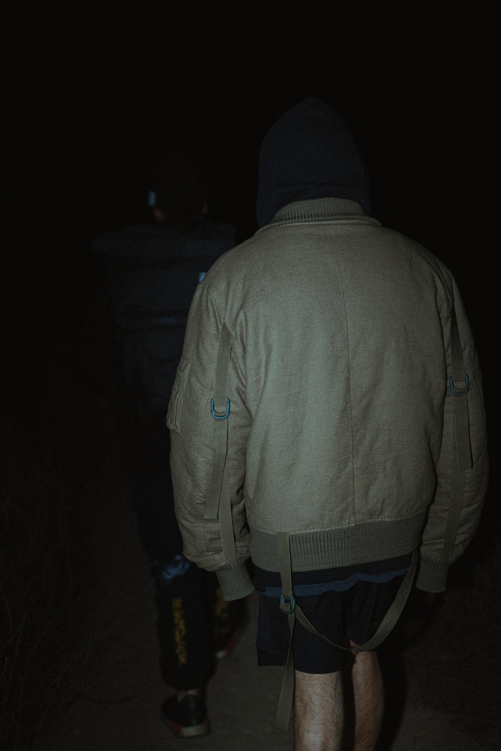 man in gray hoodie and blue denim jeans