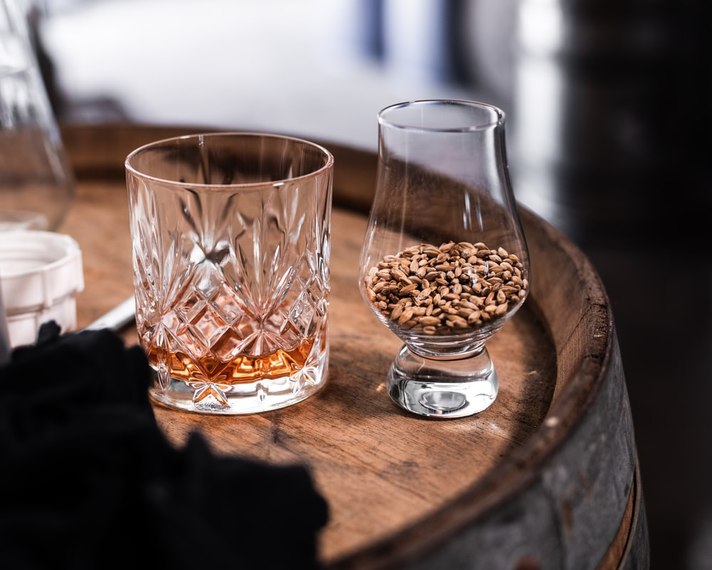 clear drinking glass on brown wooden table