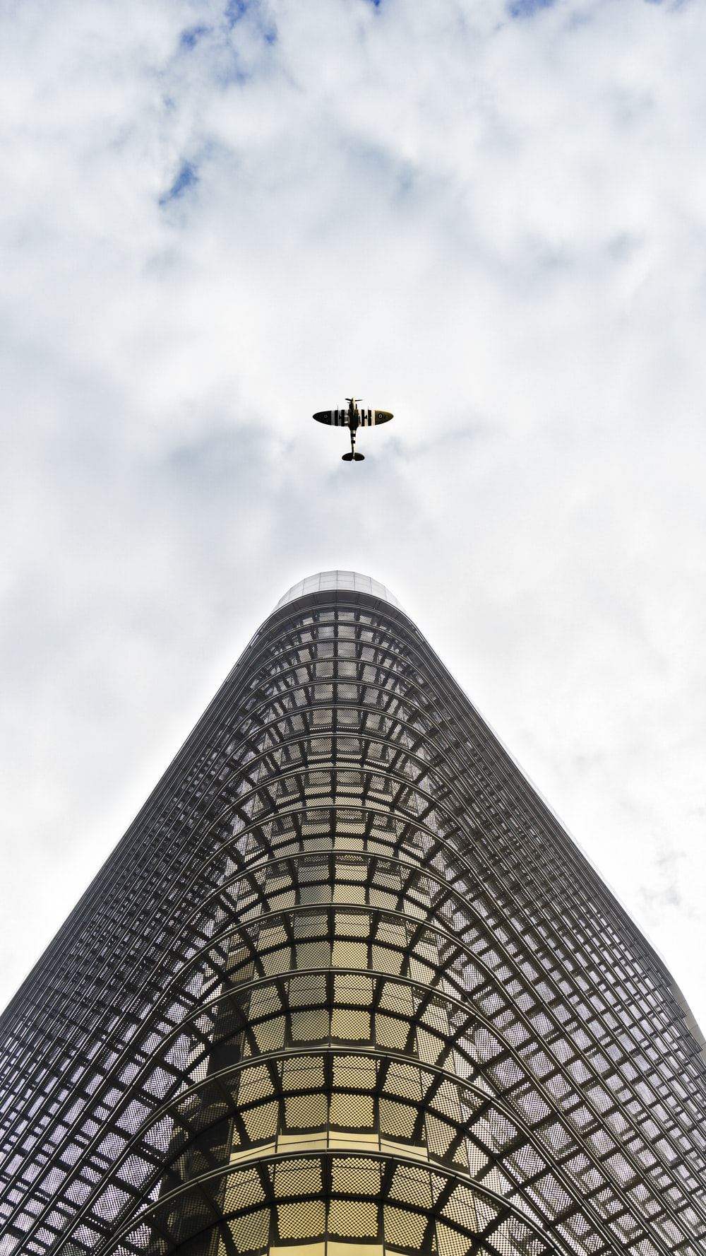 airplane flying over the building