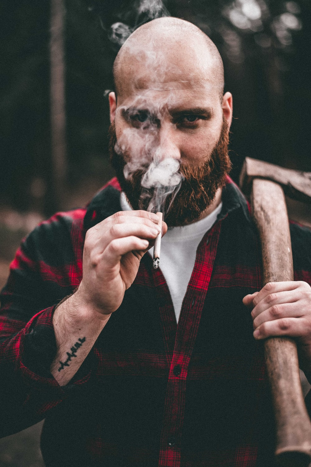 man in red and black jacket smoking