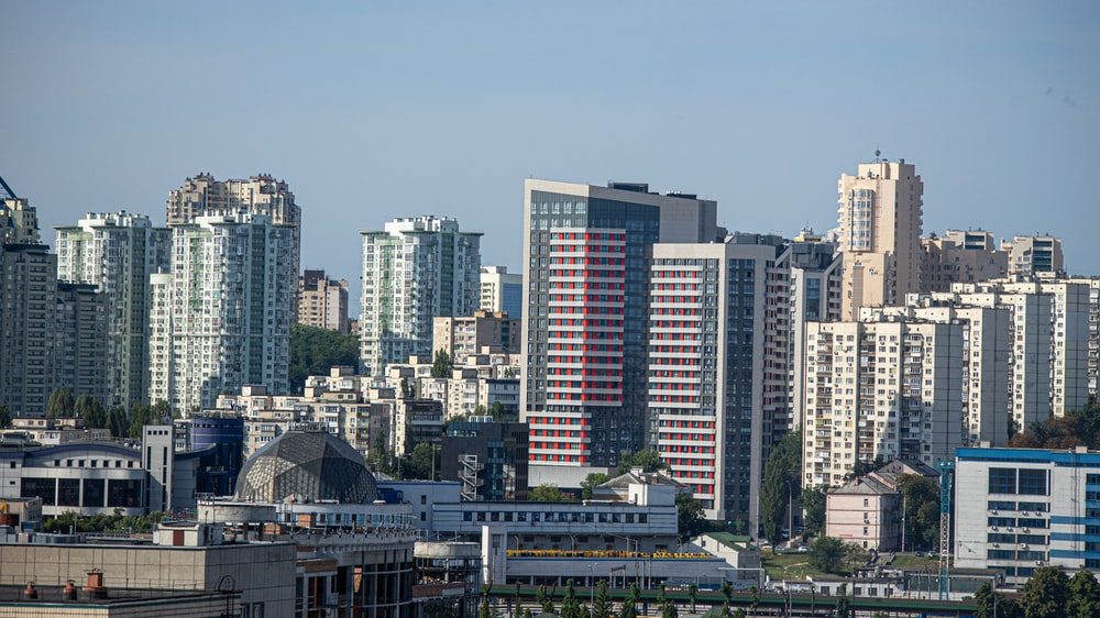 city buildings under blue sky during daytime